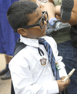 Jessy Castillo, 9, of Lebanon dresses as his favorite character, Harry Potter, during the Harry Potter party that took place at the Marion County Public Library on Thursday.