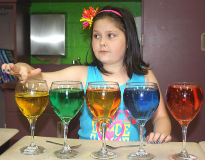 Tori Morgeson plays a melody on water glasses.