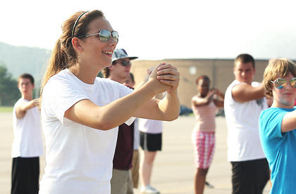 Madison Cassidy smiles in her cool sunglasses as she holds a stance during band camp last week.