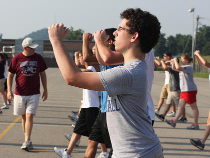 Parker Raikes practices his steps during band practice.
