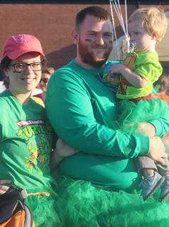 Rachel Hughes and Josh Thompson with son Owen Thompson before the Back Tutu School 2.2-mile Family Fun Run/Walk on Saturday July 25.