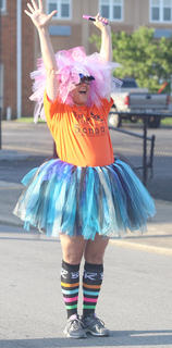 Lesli VanWhy cheers on her son Harry VanWhy who finished first in the Back Tutu School 2.2-mile Family Fun Run/Walk.