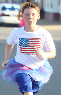 Michael Masterson is decked out in patriotic attire for the Back Tutu School 2.2-mile Family Fun Run/Walk July 25.