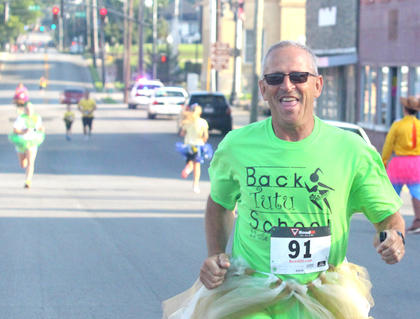 Otha Allen grins big while finishing the Back Tutu School 2.2-mile Family Fun Run/Walk.