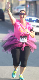 Cori Followell goes for a high-five on July 25 during the Back Tutu School 2.2-mile Family Fun Run/Walk.