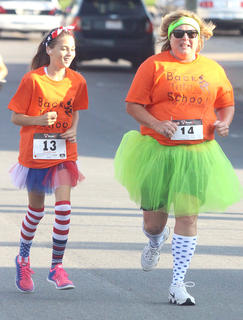 Paige Beavers and Lisa Brown run together during the Back Tutu School 2.2-mile Family Fun Run/Walk.