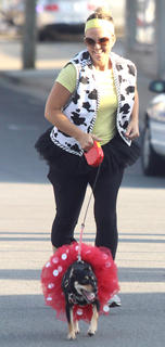 Terri Miles runs with dog Millie during the Back Tutu School 2.2-mile Family Fun Run/Walk on July 25.