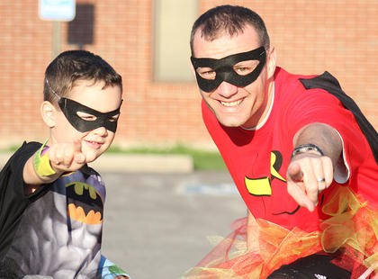 Tanner (Batman) and Kaelin Reed (Robin) get ready to battle the Back Tutu School Run.