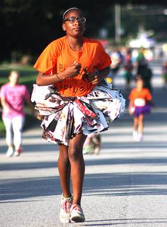 Imani Biggers runs in a tutu created from magazine pages.