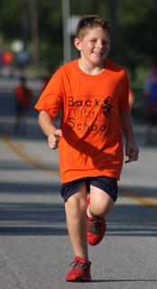 Caden Broyles dashes along the Back Tutu School Run course.