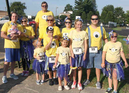 A whole family of Minions gather together after finishing the Back Tutu School Run.