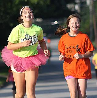 Isabella Glasscock, left, and Abbigail Adams enjoy participating in the Back Tutu School Run.