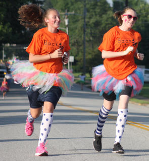 Abbey Ford, left, and Lily Alford approach the turn-around at the Back Tutu School Run.