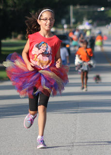 Amira Bowman keeps running in her Wonder Woman outfit.