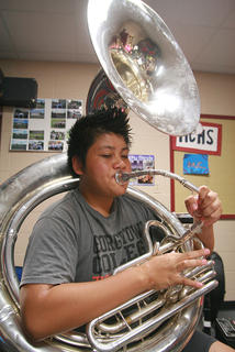 Sophomore Louis Obata works on learning this year's music on the tuba.