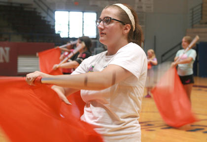 Junior Kennedy Mayo practices her flag technique.