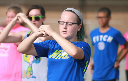 Seventh-grader Mattie Bartley checks her position during a marching drill.