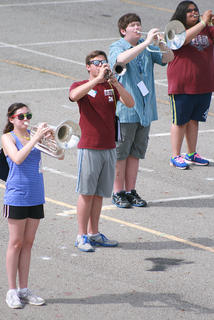 From left, sophomores Laura Ackermann and Jordan Hourigan, junior Zach Nalley and freshman Autumn Smith work on add movement with their musical performance.