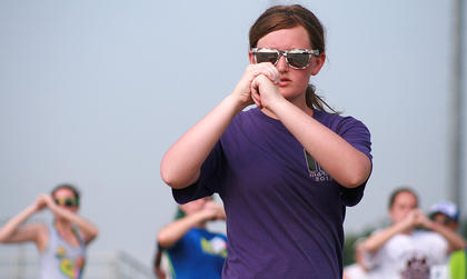Junior Lexi Cambron keeps focused during a marching drill.