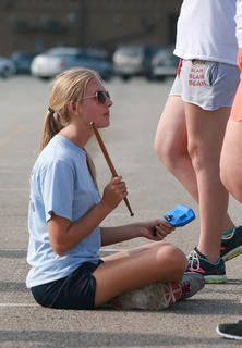 Junior Sara Jean Hughes, this year's drum major, takes a seat as her bandmates work on marching. If her bandmates marched correctly, none of them should touch her, according to the band director.