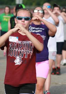 Eighth-grader Breanna Morris practices marching.
