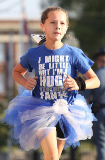 Madison Marshall blasts through the Main Street/Spalding Avenue intersection in her blue and white tutu.
