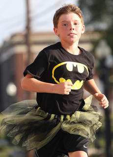 Michael Ryan Masterson shows off his super hero speed dressed as Batman.