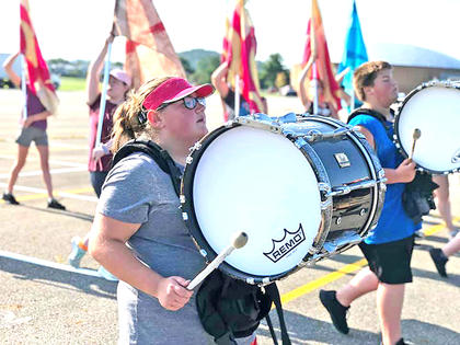 Pictured are Jasmine Hite and Memphis Curry on bass drum.