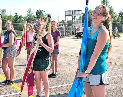 Pictured, from left, are Alexia Lackey, Rachel Potts, Shelby Coyle and Christine Mattingly, who are all members of the Knight Band Color Guard.