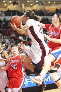 Junior Makayla Epps gets fouled as she goes to the basket againt a Lincoln County defender.