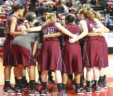 The Lady Knights huddle up as they prepare for the matchup with Manual in the state championship game.