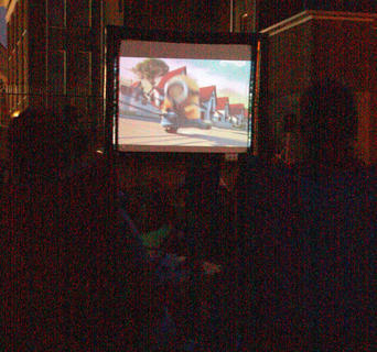 After the sunset, families sit to watch the movie on an inflatable projection screen.