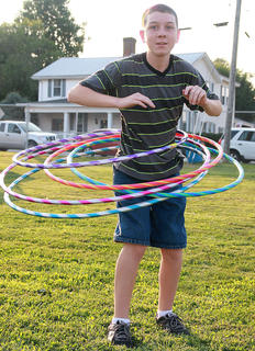 Devin Brown, 14, shows he could handle more than one hula hoop at a time.