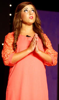 "Madeline Chandler Sandusky performs the dramatic monologue ""My First Date"" by Karen Webb during the talent portion of the competition."