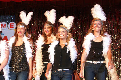 From left, Johannah Leake, Claire Hagan, Ann Thomas Daugherty and Elyssa Holt of the Glitter group dance during the introduction.