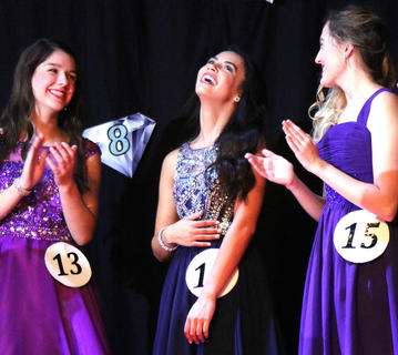 Kelly Miles reacts after she was announced as the winner of the 2019 Marion County Distinguished Young Women competition Saturday evening. Also pictured are Alyssa Followay, left, and Makayla Spalding.