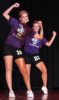 Taylor Howard (No. 18) and Kendal Violette (No. 23) perform the fitness routine.