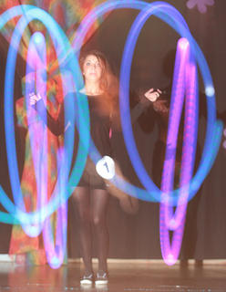 Jade Mattingly demonstrated poi, a Polynesian dance, using lighting batons.