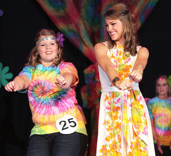 During the introduction of this year's participants, Sharon Peterson, left, dances with Kentucky Distinguished Young Woman Christine Mattingly.