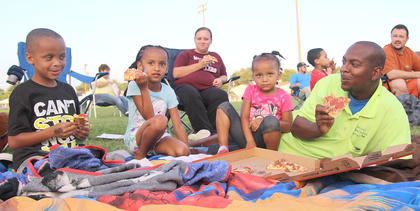 Aaron Brown, far right, enjoys some pizza with (from left), Rashad, Adriana, and Zariayah Brown. Alicia Coulter is seated behind them.