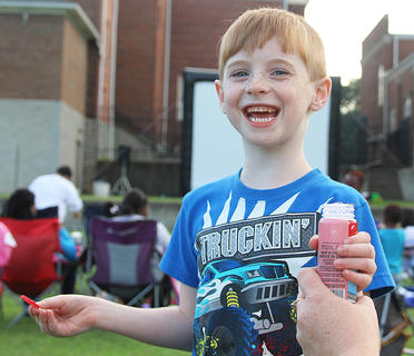 Aaron Livers, 5, was having a ball in between blowing bubbles.