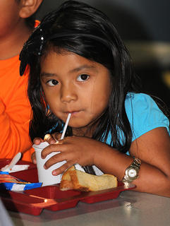 Many of the children got a bite to eat before the start of class at Lebanon Elementary. Here, Hailey Chavez gets a refreshing sip from her drink.