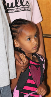 Adriana Brown holds on to her father's (Aarion Brown's) hand at Lebanon Elementary School.