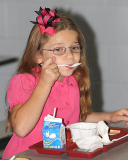 Knowing breakfast is the most important meal of the day, Olivia Lindsey gets in a quick bite before her first day of school at Lebanon Elementary School.