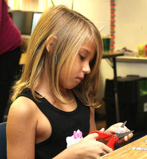 A student at Calvary Elementary works on an activity before class gets started on the first day of school.