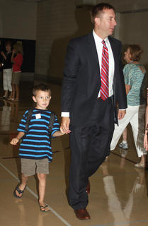 West Marion Elementary School Principal Benji Mattingly walks hand in hand with Jason Hagan as students are dismissed to their classrooms.