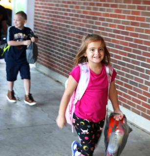 Taylor Grubbs walks into Calvary Elementary on the first day of school with confidence.