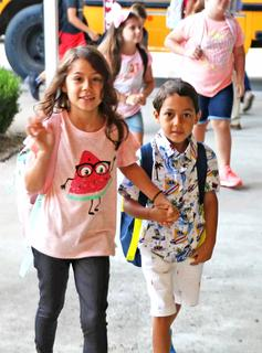 Selena and Benjamin Bone take on the first day of school together.