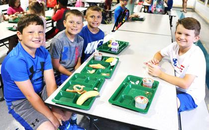 Pictured, clockwise, are Ace Farmer, Connor Cox, Andy Cox and Landon Craig enjoying a back to school breakfast together.