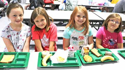 Third and second grade friends Vanessa Bays, Izabella Barnes, Kayeslynn Haley and Hayden Fowler enjoy breakfast together on the first day of school.